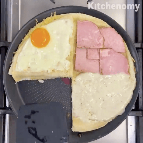 he French Croque Madame, with white bread, by @kitchenomy.paris. The tortilla wrap technique applied.