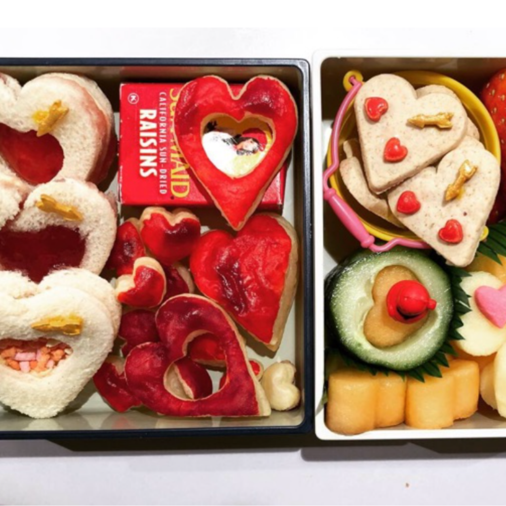 Cookies and heart-shaped sandwiches. Valentine's Day bento lunch box idea for kids.