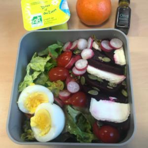Jenna Bento lunchbox with salad, cherry tomatoes, radishes